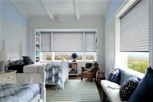 Motorized Blinds by Hunter Douglas in Sonnet on two windows in children's bedroom